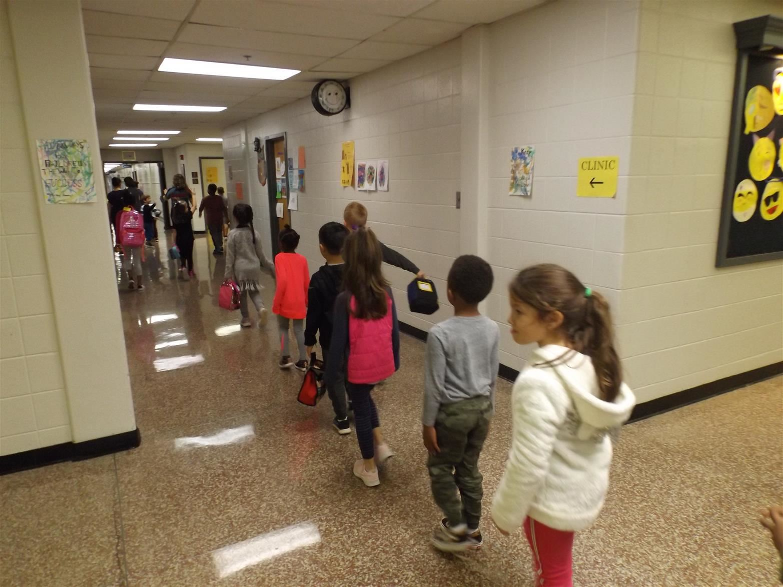 Students walking down hall in a line